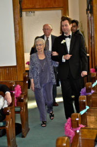 I escort Betty to her seat at our wedding. Her husband, my grandfather-in-law, is behind us. (Yes, we have a hard copy of this now.)